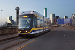 A BROOKVILLE Liberty Streetcar crosses the Houston Street Viaduct in Dallas during the summer of 2015. BROOKVILLE is shipping its third streetcar to Dallas the week of June 27, 2016.