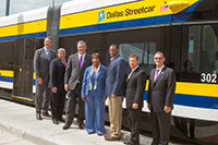 Left to right are Gary Thomas, DART President/Executive Director; Mike Cantrell, Chair, Regional Transportation Commission; Mike Rawlings, Mayor of Dallas; US Rep. Eddie Bernice Johnson; US Rep. Marc Veasey; Jim Crites, Executive VP, DFW International Airport; Rick Stopfer, DART Board Member.