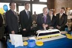 Image: Rowlett Mayor John Harper cuts the ceremonial DART Rail cake as Gary Thomas, DART President/Executive Director, Randall Chrisman, DART Chairman of the Board, Mike Cantrell, Dallas County Commissioner, and Mark Enoch, DART Board Member, look on.