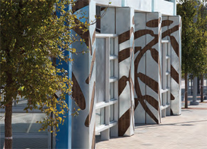 Mesquite tree leaves adorn station columns and windscreens at North Lake College Station.