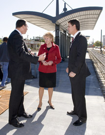 Image: DOT Secretary Mary Peters talking with DART President/Executive Director Gary Thomas (left) and DART Board Chairman Randall Chrisman