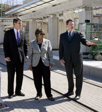 Image: Congresswoman Eddie Bernice Johnson and DART Board Chairman Randall Chrisman look on as DART President/Executive Director Gary Thomas conducts a tour of the future Fair Park Station.