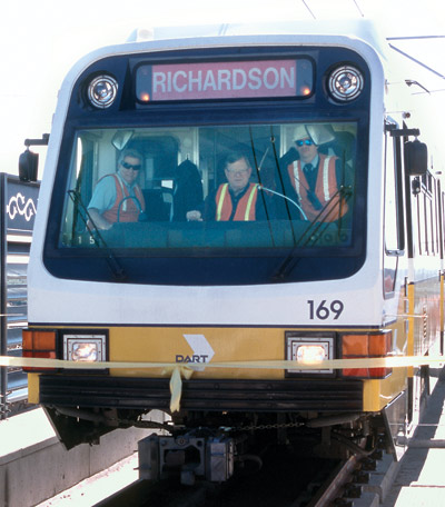 Ray Noah at the controls of the first DART train to pull into Richardson in 2002