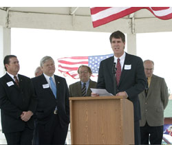 Speakers at the event included Marchant (second from left) and Randall Chrisman, Carrollton representative to the DART Board (speaking) and Carrollton Mayor Mark Stokes (far right).
