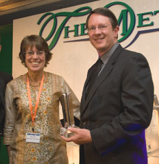 Image: DART President/Executive Director Gary Thomas accepts the 'Best Metro Americas' award from Jane Pearce, Editor of Metro Report (UK).