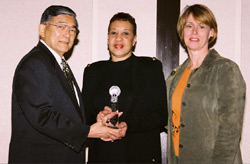 U.S. Secretary of Transportation Norman Y. Mineta (left) and Federal Transit Administrator Jennifer L. Dorn (right) presented the DOT Grant Recipient Award to DART Vice President of Diversity and Economic Development Gloria Dixon at the National Disadvantaged Business Enterprise Conference last month in Washington, D.C. DART was one of six public agencies recognized for superior efforts to enhance minority-owned and women-owned business participation in contracts and purchases.