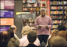 Willie Sims reads one of this year's Poetry In Motion poems at the kick-off party at the Borders Books and Music in Uptown Dallas.